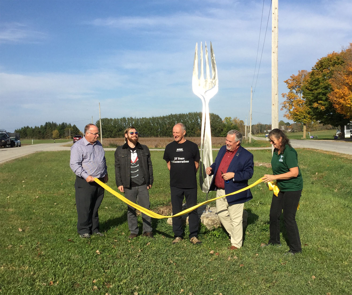 Tape cutting ceremony of the art installation 'Fork in the Road'.
